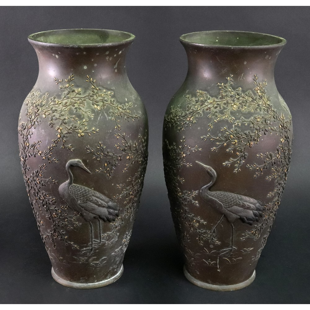 A pair of Japanese mixed metal vases, Meiji period, of slender ovoid form, each decorated in... Image
