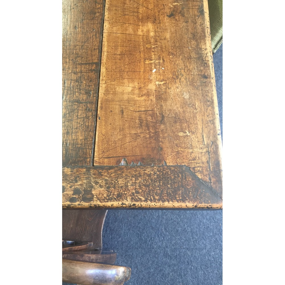 A French Provincial walnut refectory table, 18th century, the cleated planked rectangular top on... Image