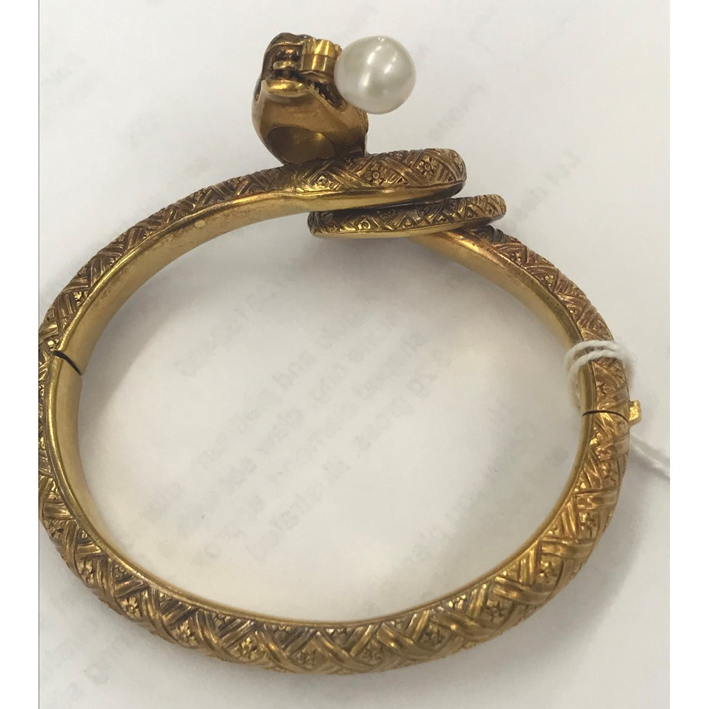 A 19th century gold, diamond, colourless gem and cultured pearl set hinged bangle, in a coiled... Image