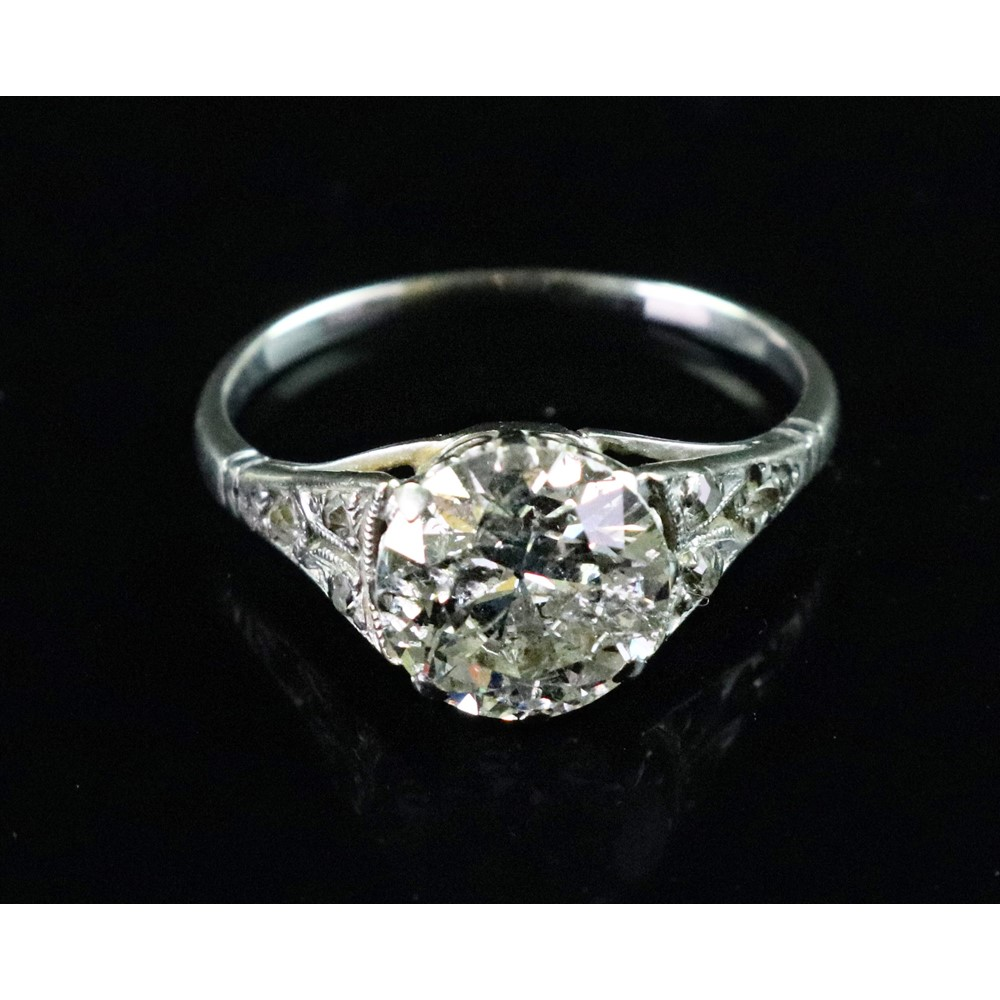 A diamond solitaire ring, the central old cut, approximately 2cts, within rose cut diamond set... Image