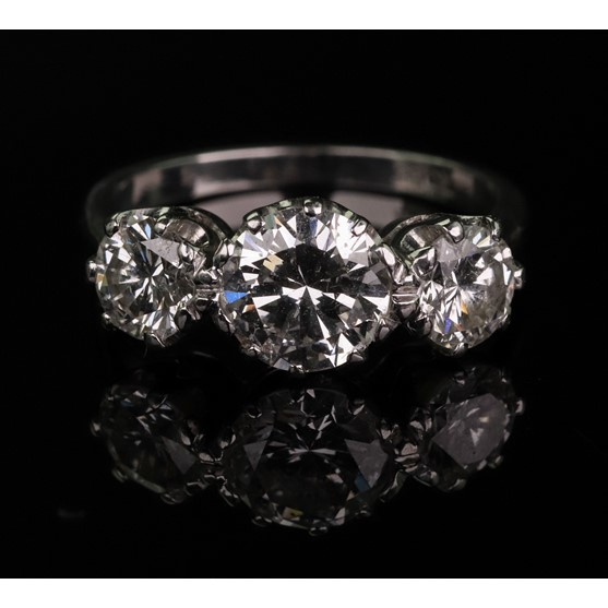 An 18ct white gold and diamond three-stone ring, total diamond weight approximately 2.10ct, ring... Image