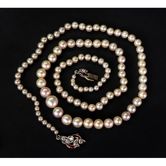 A single-row natural pearl necklace, designed as a graduated row of 105 pearls from 2.64 - 7.82mm... Image