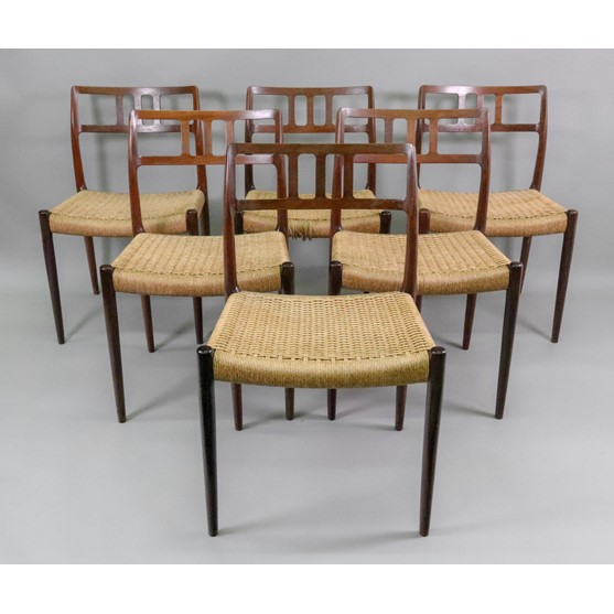 J L Moller Models, Denmark; a set of six rosewood dining chairs, the curved open backs with three... Image