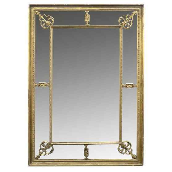 A moulded giltwood and gesso frame marginal wall mirror, early 19th century, the bevelled... Image