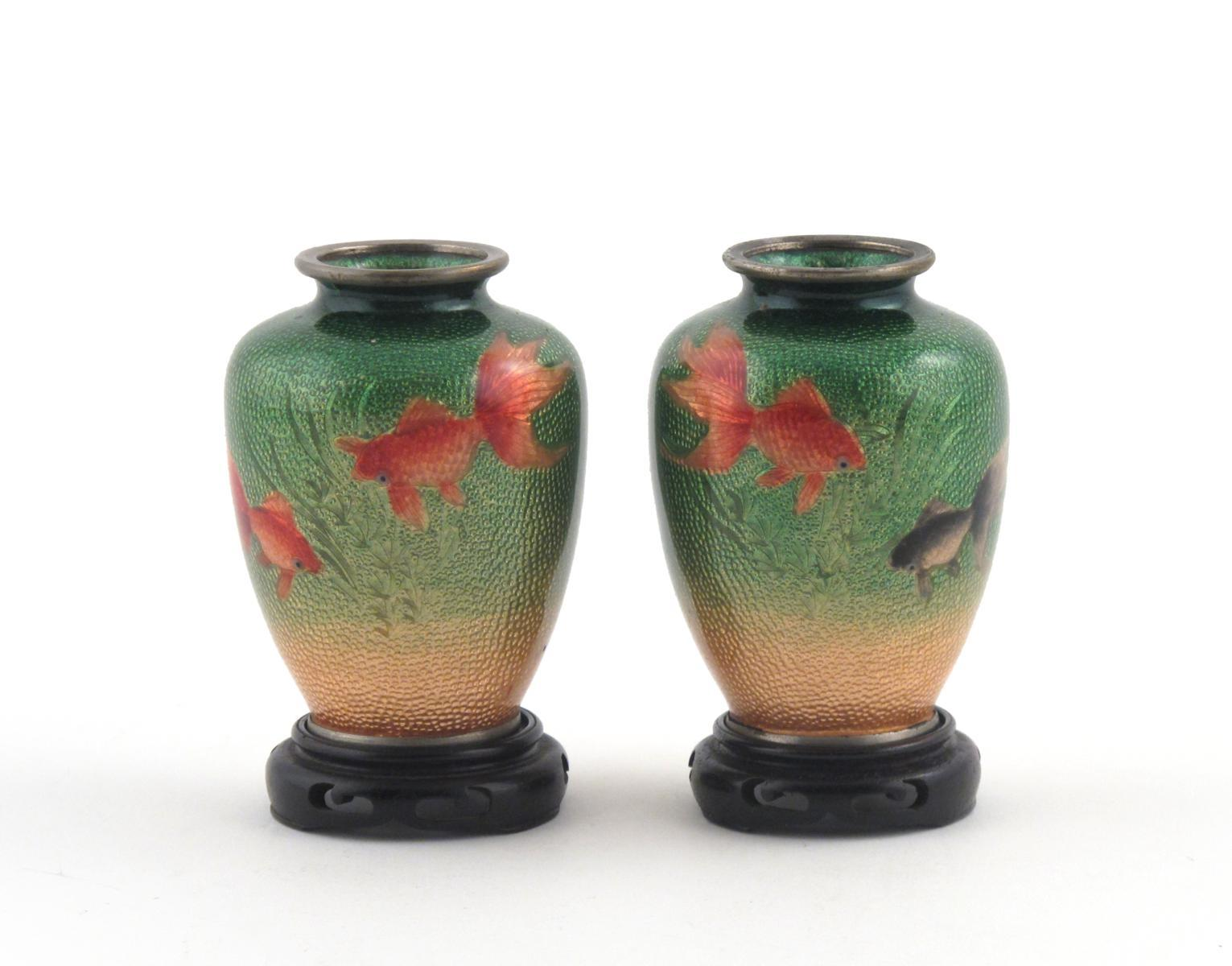A pair of small japanese jin barrie enamel vases 20th century a pair of small japanese jin barrie enamel vases 20th century each decorated with three fish on a textured foil ground each with a wood stand 92cm 4 reviewsmspy