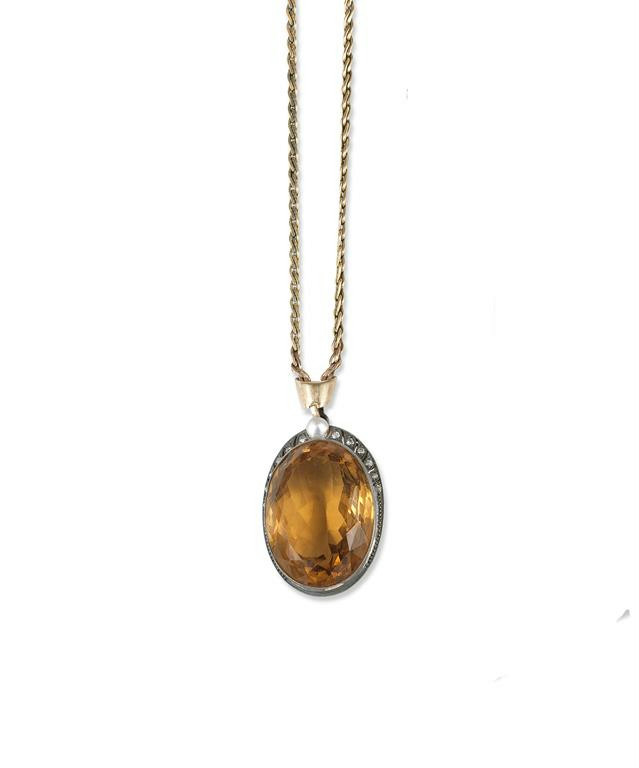 A large citrine pendant lot 1062 jewellery a large citrine pendant the oval shaped citrine is millegrain set below a row of graduated single cut diamonds and a central pearl aloadofball Choice Image