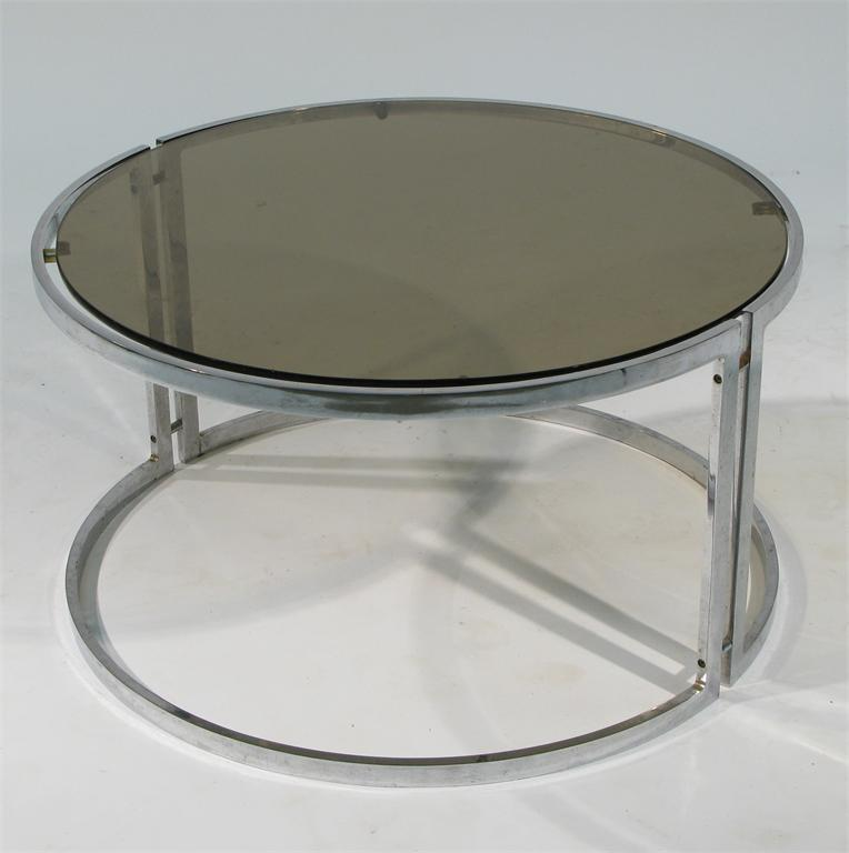 A William Plunkett Furniture Polished Steel And Amethyst Glass Table  Designed By William Plunkett, Circular Section, Unsigned 76cm. Diam.  Literature