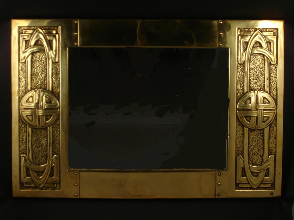 A Margaret Gilmour Studio beaten brass wall mirror designed by